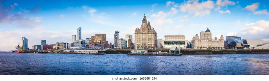 Panoramic view of Liverpool waterfront,  including modern office buildings and the River Mersey.