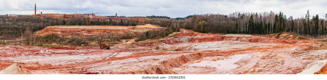 Panoramic view of Lode brick factory, Latvia. Old brick factory and red clay career. Bricks production.               - Shutterstock ID 1703652301