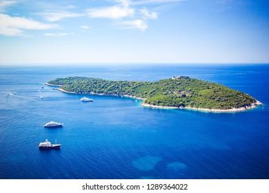 Panoramic view of Lokrum Island Dalmatian Coast of Adriatic Sea in Dubrovnik. Blue sea with white yachts, beautiful landscape, aerial view, Dubrovnik, Croatia