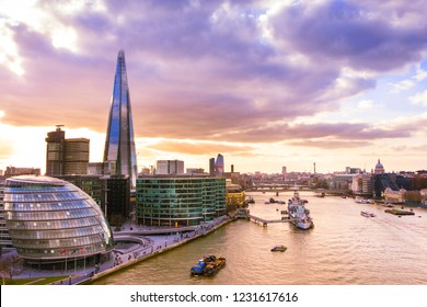 Panoramic view of London skyline. Cityscape with the Shard and the City hall building in sunset light