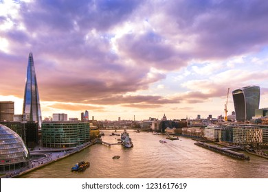 Panoramic view of London skyline. Cityscape with modern buildings and the river Thames in sunset light