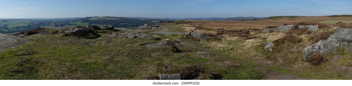 A panoramic view looking north along Curbar Edge, a millstone grit outcrop high above the village of Curbar in The Derbyshire Dales, England.