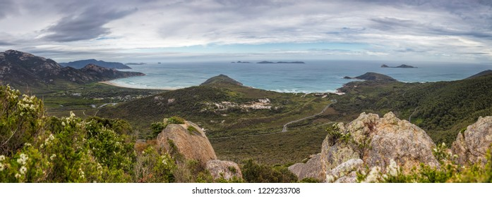Panoramic view looking out from the summit of Mount Bishop across the landscape and coastline around Tidal River in Wilsons Promontory national park, Victoria, Australia
