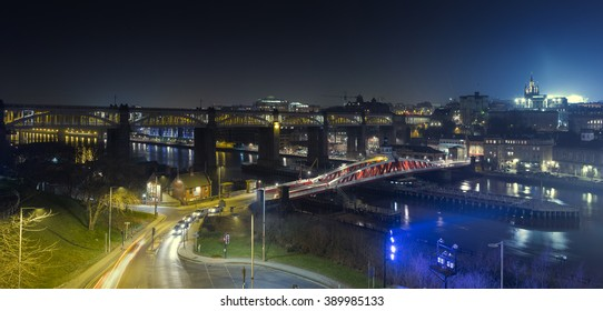 Panoramic view looking toward the High Level Bridge and Swing Bridge and beyond to Newcastle upon Tyne from the Gateshead side of the river. The Castle Keep, Cathedral and St James Park are visible.