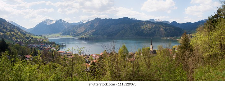 panoramic view from lookout point haider-denkmal to lake schliersee and bavarian alps at springtime