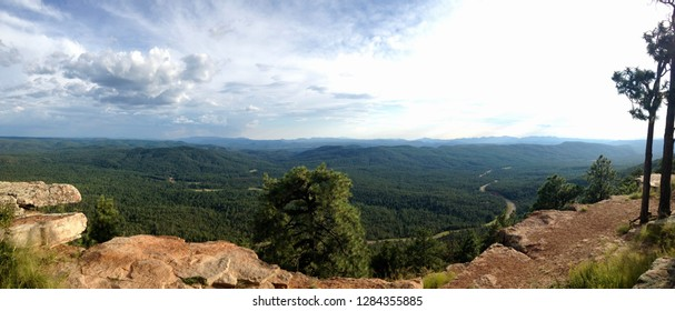 Panoramic view from lookout point at the Mogollon Rim outside of Payson Arizona with storm clouds & rain in the distance