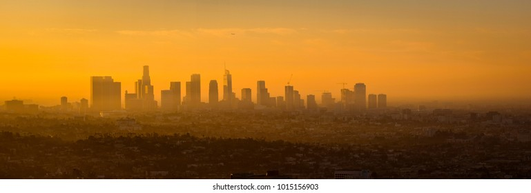 Panoramic view of Los Angeles skyline at sunrise, viewed from Griffith observatory, California, USA