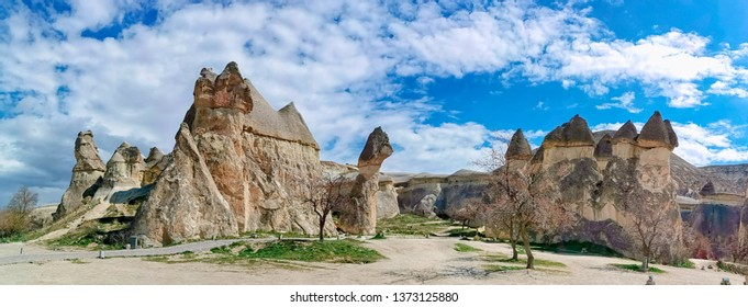 Panoramic view of the Love valley with huge phallus shape stones in Goreme village, Turkey. Rural Cappadocia landscape. Volcanic mountains in Goreme national park. Countryside lifestyle.