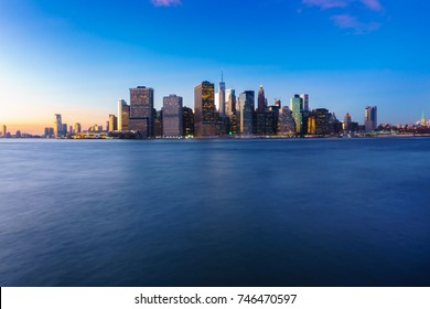 Panoramic view of Lower Manhattan and Jersey City at early night, New York City.