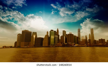 Panoramic view of Lower Manhattan skyline from Brooklyn Bridge Park on a sunny day - New York City.