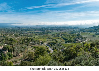 Panoramic view of the Luberon Valley, in autumn. The colorful Vineyards, The Hills. Provence, France, Menerbes.