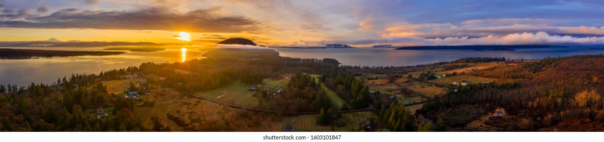 Panoramic View of Lummi Island, Washington. Aerial view of Lummi island during a glorious winter sunset looking south towards Bellingham and Cypress Island. The island is surrounded by the Salish Sea.