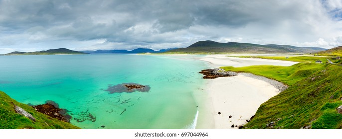 Panoramic view of Luskentyre white beaches under dramatic sky, Isle of Harris, Scotland