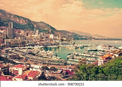 Panoramic view of luxury yachts and apartments in harbor of  of Monte Carlo, Monaco. Travel background with retro vintage instagram filter