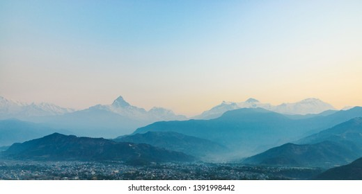 Panoramic view of the Machapuchare and the Annapurnas at sunrise from Sarangkot in Nepal