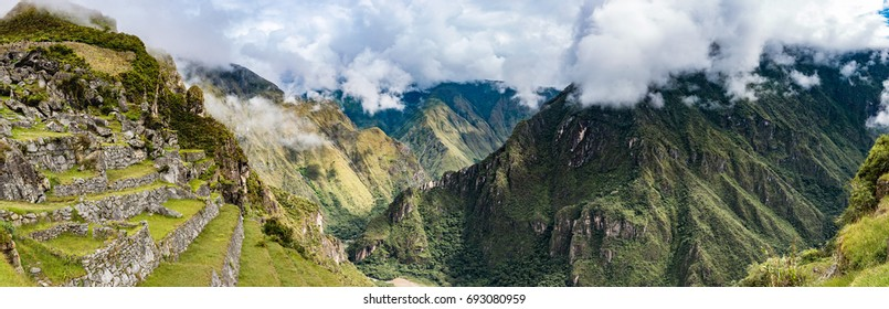 Panoramic view from Machu Picchu agricultural terraces to Urubamba river valley