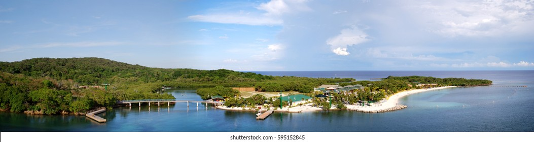 The panoramic view of Mahogany Bay landscape and the beach on Roatan island.