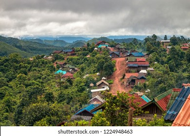 Panoramic View of Main Street in Akha Hill Tribe Village on Mountain Top in Nam Ha National Protected Area. Small Ethnic Village in Laotian Rainforest Surrounded by Mountains (Luang Namtha, Laos).