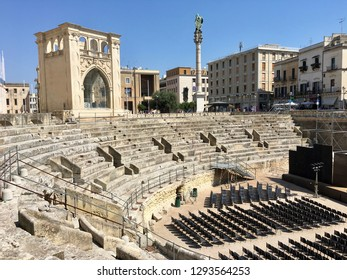 Panoramic view of the majestic Roman amphitheater of Lecce built during the augustan age (I, II century a.C.) and discovered by the archeologist Cosimo De Giorgi | Lecce, Puglia - Italy 22/08/2017