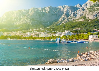 Panoramic view of Makarska coast architecture seascape with high mountains on background, Croatia