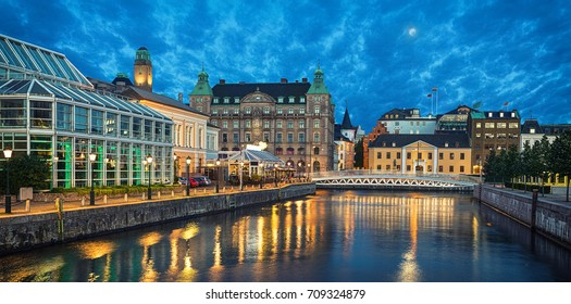 Panoramic view of Malmo skyline from canal in the evening, Sweden