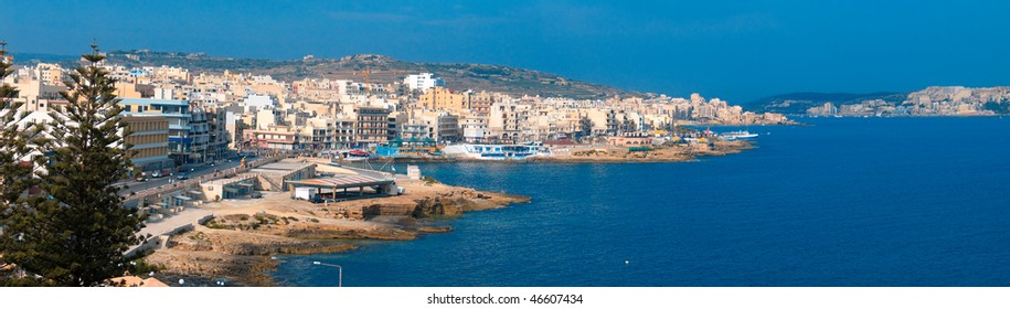 Panoramic view of maltese town Bugibba and its bay area