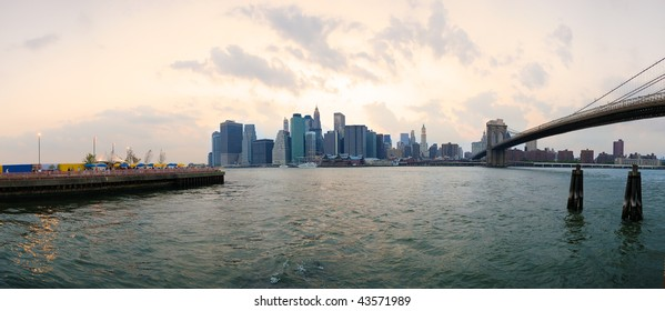 Panoramic view of Manhattan at down, from near the Brooklyn Bridge