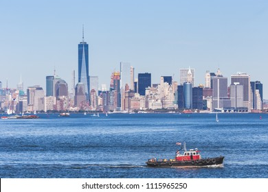 Panoramic view of the Manhattan Island on a sunny day from the Staten Island Ferr