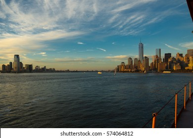 Panoramic view of the Manhattan Island on a misty sunset from the Staten Island Ferry, New York, United States