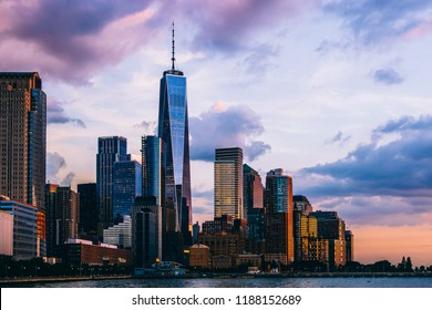 Panoramic view of Manhattan Island with sunset reflection in glass buildings.Scenery skyline view of contemporary skyscrapers of downtown financial district in New York. Gold sunset over NYC cityscape
