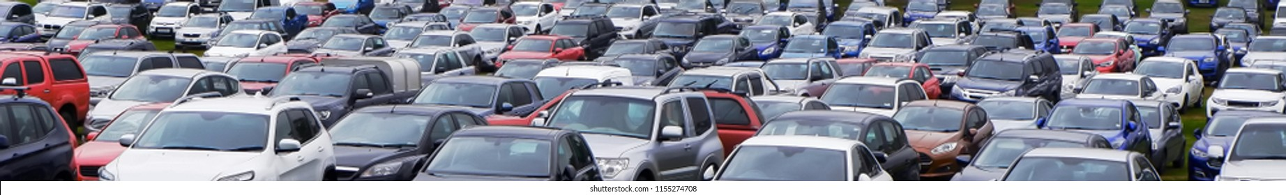 """""""Panoramic view of many parking cars over the tops"""""""