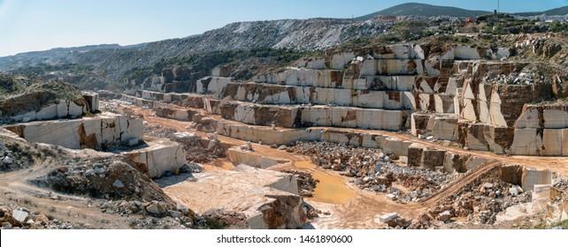 Panoramic view of marble quarry pit full of rocks and blocks in Marmara island, Balikesir, Turkey