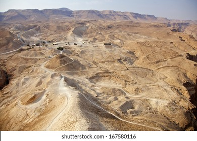 Panoramic view of Masada summit and Dead Sea in Judea Negev desert, Israel.