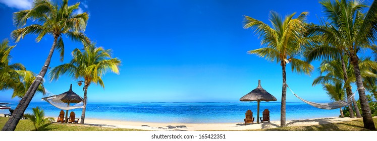 Panoramic view of Mauritius beach with chairs and umbrellas