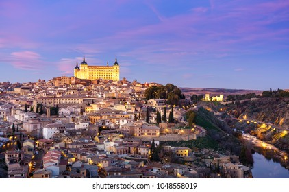 Panoramic view of the medieval center of the city of Toledo, Spain. It features the Tejo river, the Cathedral and Alcázar of Toledo.