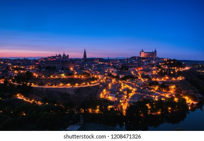Panoramic view of the medieval center of the city of Toledo, Spain. It features the Cathedral and Alcazar of Toledo, Spain.