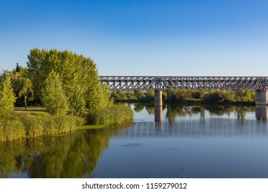 Panoramic view of the metal railway bridge as it passes through the Guadiana River, built by Eiffel. Merida Spain