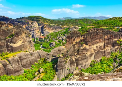Panoramic view of Meteora monasteries on the high cliff rock in the mountains at spring time, Greece