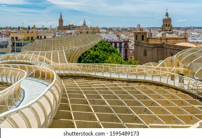 Panoramic view from the Metropol Parasol terrace on a sunny summer afternoon in Seville, Andalusia, Spain.