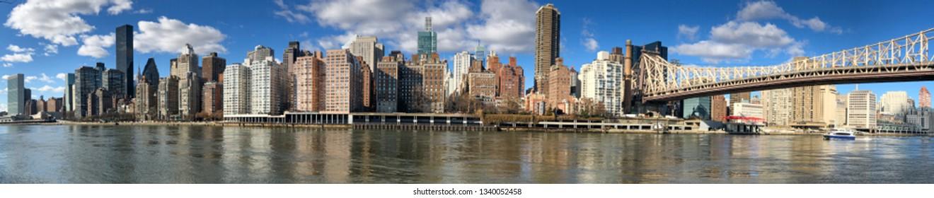 Panoramic view of Midtown Manhattan skyline from Roosevelt Island, New York City.