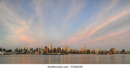 Panoramic view of Midtown Manhattan skyline with dramatic cloud formations