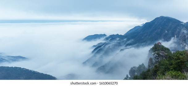 panoramic view of misty landscape at mount lu, watching clouds pavilion and cloud fog background, China