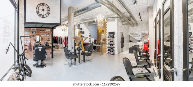 Panoramic view of a modern bright beauty salon. Hair salon and make up store, barber shop and manicure interior business