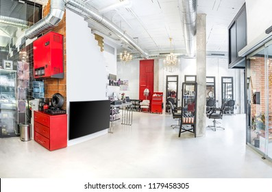 Panoramic view of a modern bright beauty salon. Hair salon and make up store, barber shop and manicure interior business with coffee and drinks dispensers
