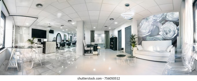 Panoramic view of a modern bright beauty salon. Hair salon interior business