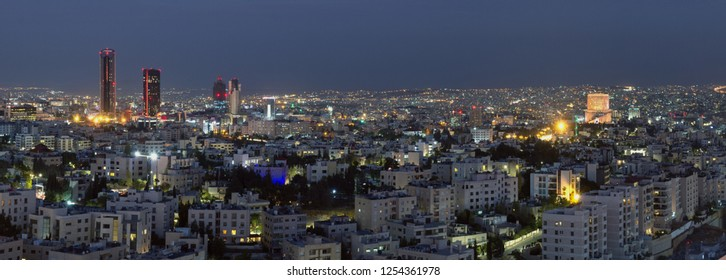 Panoramic view the modern buildings of Amman city at night - View of the new downtown of Amman city at night