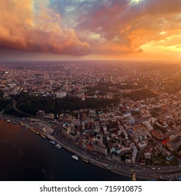 Panoramic view of a modern city at sunset. Skyline bird eye aerial view of the old part of the city under dramatic cloud sunset sky. Pochtovaya square, Vladimirskaya Gorka, St. Andrew's Church, St