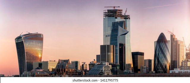 Panoramic view to the modern skyscrapers o the City of London during early morning sunrise, UK