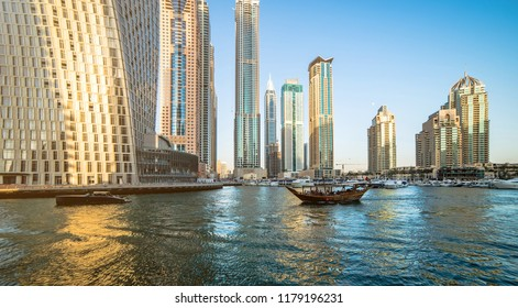 Panoramic view of modern skyscrapers and water channel of Dubai Marina, United Arab Emirates