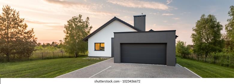 Panoramic view of modern suburban house with single garage